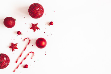 Christmas composition. Red decorations on white background. Christmas, winter, new year concept....