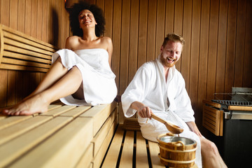 Couple relaxing, resting and sweating in sauna