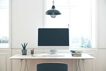workplace with empty computer screen