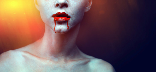 Zombie vampire woman with bloody lips and blue skin portrait. Fashion glamour halloween art design concept