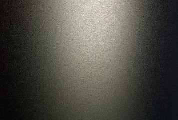 Ground glass texture in black color with light.
