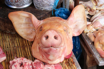 Fresh pork head sold in a market