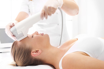 Face lifting. A rejuvenating cosmetic care treatment in aesthetic medicine clinic.