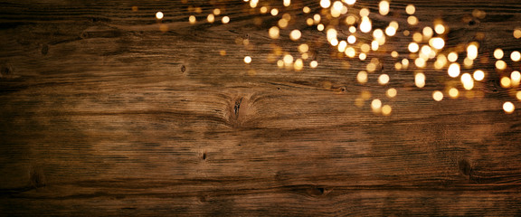 Fotobehang Hout Christmas lights on old wood