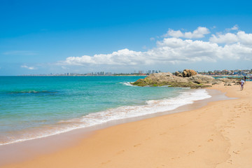A view of Farol de Itapua beach - calm waters and beautiful turquoise sea - Salvador, Bahia (Brazil)