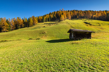 Wall Mural - Autumn rural mountains scene with traditional alpine hut. Hiking in Austrian Alps, Tyrol, Austria.