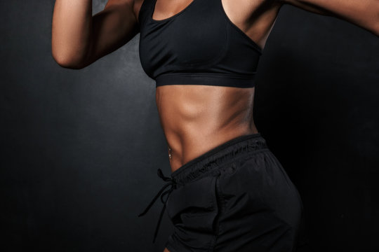 Cropped image of african american woman in sportswear running