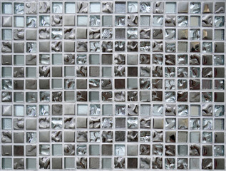 Shiny silver mosaic wall texture background.
