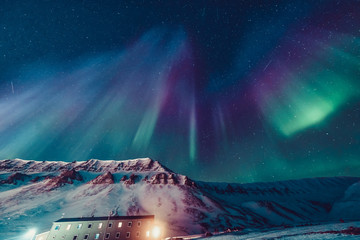 Stores à enrouleur Aurore polaire The polar arctic Northern lights hunting aurora borealis sky star in Norway travel photographer Svalbard in Longyearbyen city the moon mountains