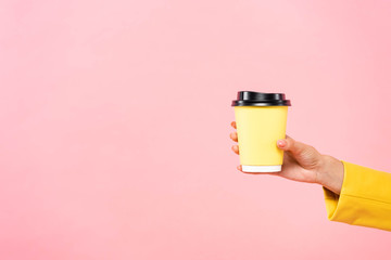 Custom vertical slats for kitchen with your photo cropped view of woman holding yellow disposable cup of coffee, isolated on pink