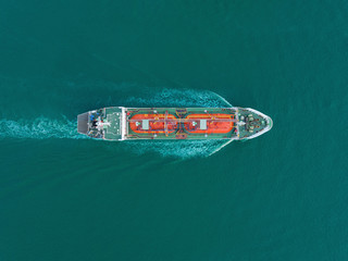 Aerial top view Oil or LPG ship tanker transportation oil or LPG gas from refinery on the sea.