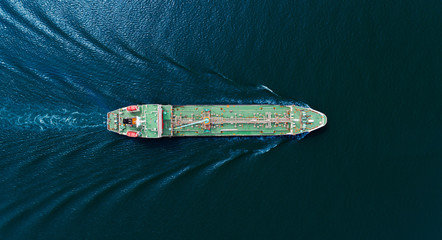 Aerial top view Oil ship tanker for transportation oil from refinery on the sea.