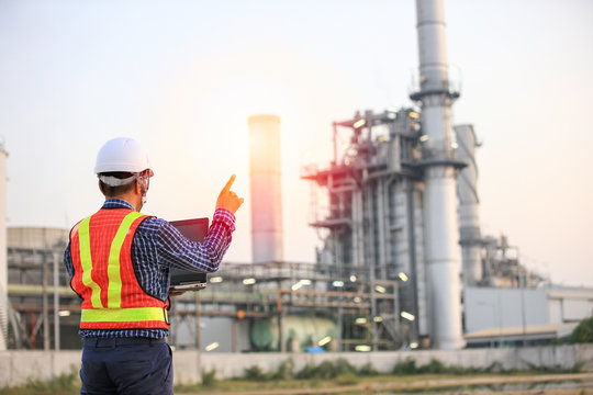 Senior engineer audit job at site line , mid age engineer using laptop computer work at outdoor