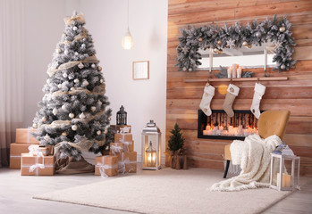 Foto op Canvas Kerstmis Festive interior with decorated Christmas tree and fireplace