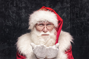 Portrait of real Santa Claus with white beard.