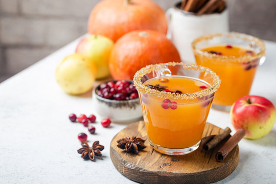 Spicy hot pumpkin punch or sangria in a glass with apple, cinnamon, anise. Halloween and Thanksgiving. Traditional autumn, winter drinks and cocktails