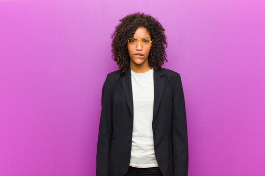 young black business woman feeling clueless, confused and uncertain about which option to pick, trying to solve the problem