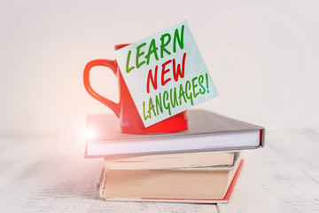 Conceptual hand writing showing Learn New Languages. Concept meaning developing ability to...