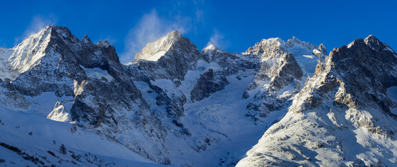 Panoramic winter view of mountain peaks of the Ecrins National Park. Pic Gaspard, Pic Oriental, La Meije and Bec de l'Homme with Glacier du Lautaret. Hautes-Alpes, Col du Lautaret, Alps, France