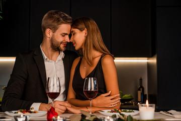 Fototapeta Sweet couple having romantic dinner at home obraz