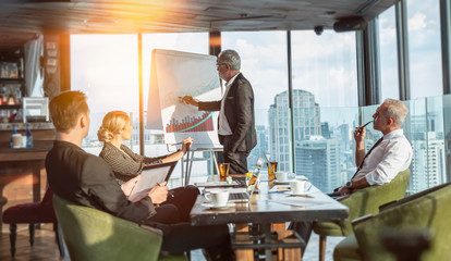 Meeting and discussion concept.business people communicating in office.Mature businessman discuss information with a colleague in a modern business lounge high up in an office tower.