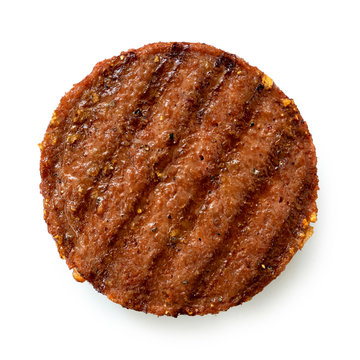 Plant based grilled burger patty with grill marks isolated on white. Top view.