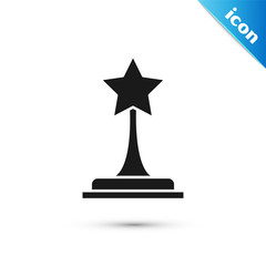 Black Movie trophy icon isolated on white background. Academy award icon. Films and cinema symbol. Vector Illustration
