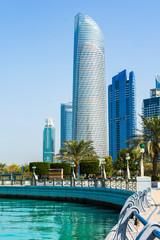 Spoed Foto op Canvas Abu Dhabi Abu Dhabi Corniche walking area with landmark view of modern bui