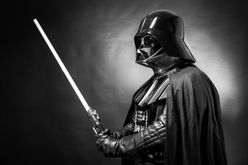 SAN BENEDETTO DEL TRONTO, ITALY. MAY 16, 2015. Portrait of Darth Vader costume replica with his sword . Darth Vader or Dart Fener is a fictional character of Star Wars saga. Black and white picture
