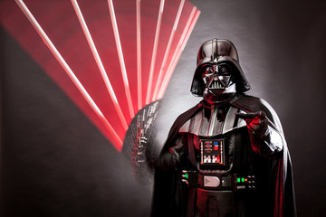 MAY 16, 2015. Stroboscopic photography of Darth Vader costume replica with grab hand and his sword .Studio photo,   Black background