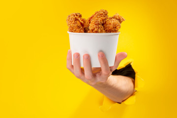 Hand giving chicken nuggets Wall mural