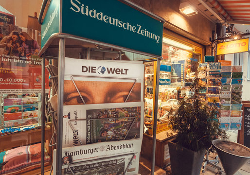 MUNICH, GERMANY - NOVEMBER 16, 2017: Newspaper stand with frontapage of tabloid Die Welt near street store on Novemebr 16. 2017. Bavaria is famous for breweries and Weissbier -wheat beer