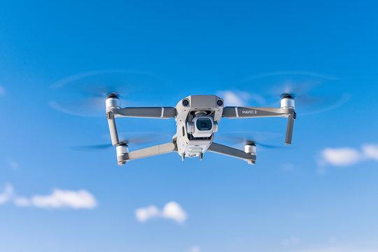 DJI Mavic 2 pro drone during flight against blue sky