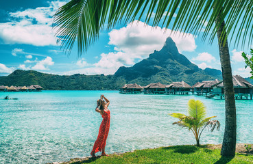 Bora Bora Tahiti vacation woman at luxury hotel in French Polynesia, tourist enjoying tropical summer resort lifestyle.