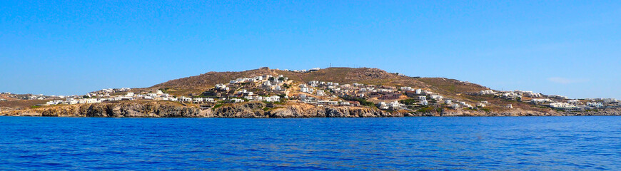 panoramic view from the sea of Mykonos, the famous Greek island of Cyclades in the heart of the Aegean Sea
