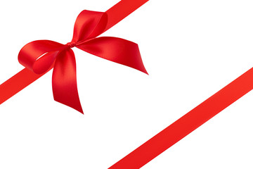 Side view of bright red beautiful simple handmade bow and two diagonal red satin ribbons with copy space isolated on white background. Gift, invitation, discount card or gift wrapping concept.