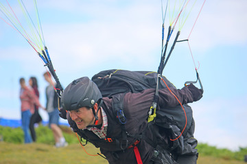 Fototapete - Paraglider launching to fly