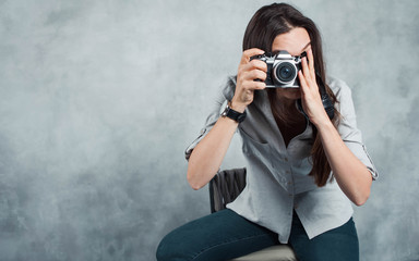 photographer takes the photo. Young successful woman content Creator.