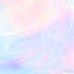 Abstract iridescent image of holographic plastic material in pastel colors