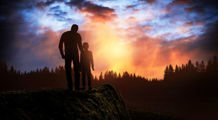 father and son at sunset