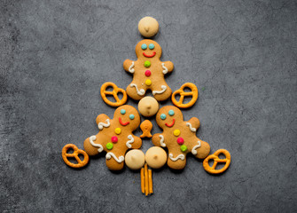Delicious Christmas gingerbread men in the form of a Christmas tree. Christmas baking ingredients...