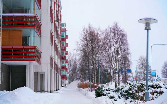 Modern residential apartment and flat building exterior and winter