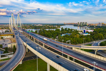 Saint-Petersburg. Russia. Traffic. Obukhov bridge across the Neva. Vansu bridge. The highway passes over a bridge. Highway. View of St. Petersburg from the drone. Road junction.
