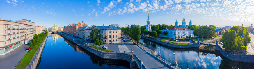 Panorama of St. Petersburg on a summer day. View of the city from a height. Russia. Rivers Of Petersburg. Kryukov canal and Griboyedov canal. Architecture Of St. Petersburg. Nikolsky Cathedral.