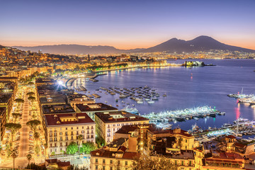 Deurstickers Napels The city of Naples in Italy with Mount Vesuvius before sunrise