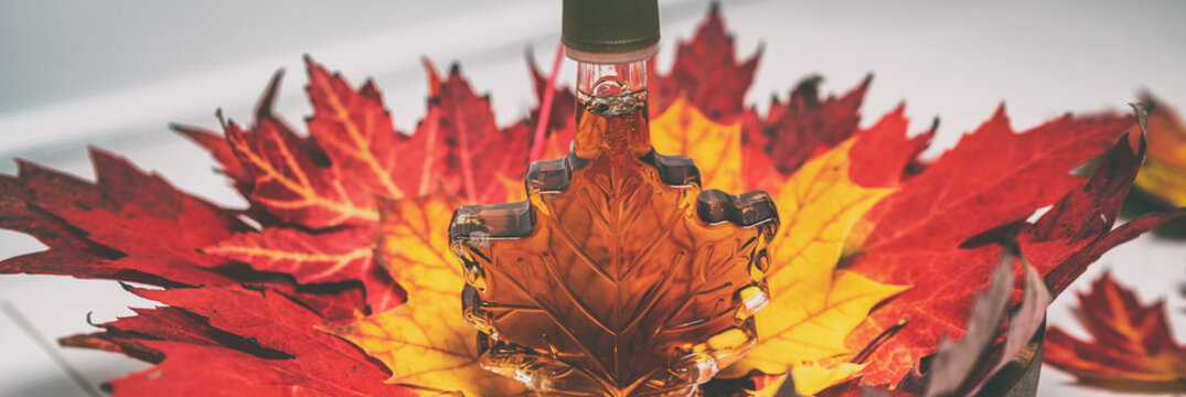 Maple syrup gift bottle in shape of leaf for tourist gift souvenir banner panorama background.
