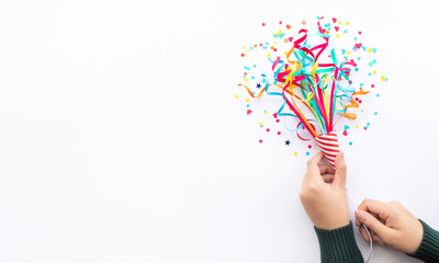 Celebration party and anniversary concepts ideas with woman hand holding colorful confetti,paper art on white color