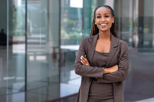 Beautiful cheerful african american executive business woman at the workspace office