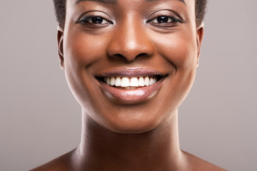 Fototapete - Portrait of black woman with perfect skin and white teeth