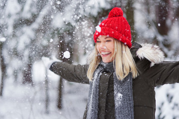 Happy woman dancing among snowflake